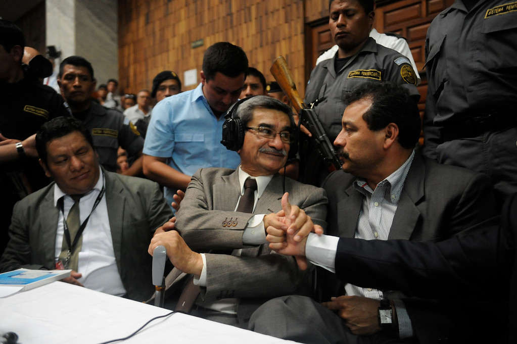 . Retired Guatemalan General Jose Rodriguez (C), former intelligence chief of former Guatemalan de facto President (1982-1983), retired General Jose Efrain Rios Montt, react after being absolved of charges of genocide committed during the de facto regime, in Guatemala City, on May 10, 2013. Rios Montt was found guilty of genocide and war crimes on Friday in a landmark ruling stemming from massacres of indigenous people in his country\'s long civil war. Rios Montt thus became the first Latin American convicted of trying to exterminate an entire group of people in a brief but particularly gruesome stretch of a war that started in 1960, lasted 36 years and left around 200,000 people dead or missing.  JOHAN ORDONEZ/AFP/Getty Images