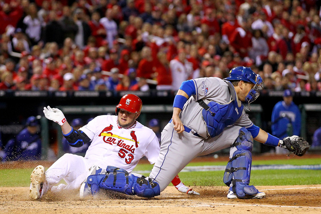 . ST LOUIS, MO - OCTOBER 18:  Matt Adams #53 of the St. Louis Cardinals slides home safely before catcher A.J. Ellis #17 of the Los Angeles Dodgers gets the ball in the fifth inning in Game Six of the National League Championship Series at Busch Stadium on October 18, 2013 in St Louis, Missouri.  (Photo by Dilip Vishwanat/Getty Images)