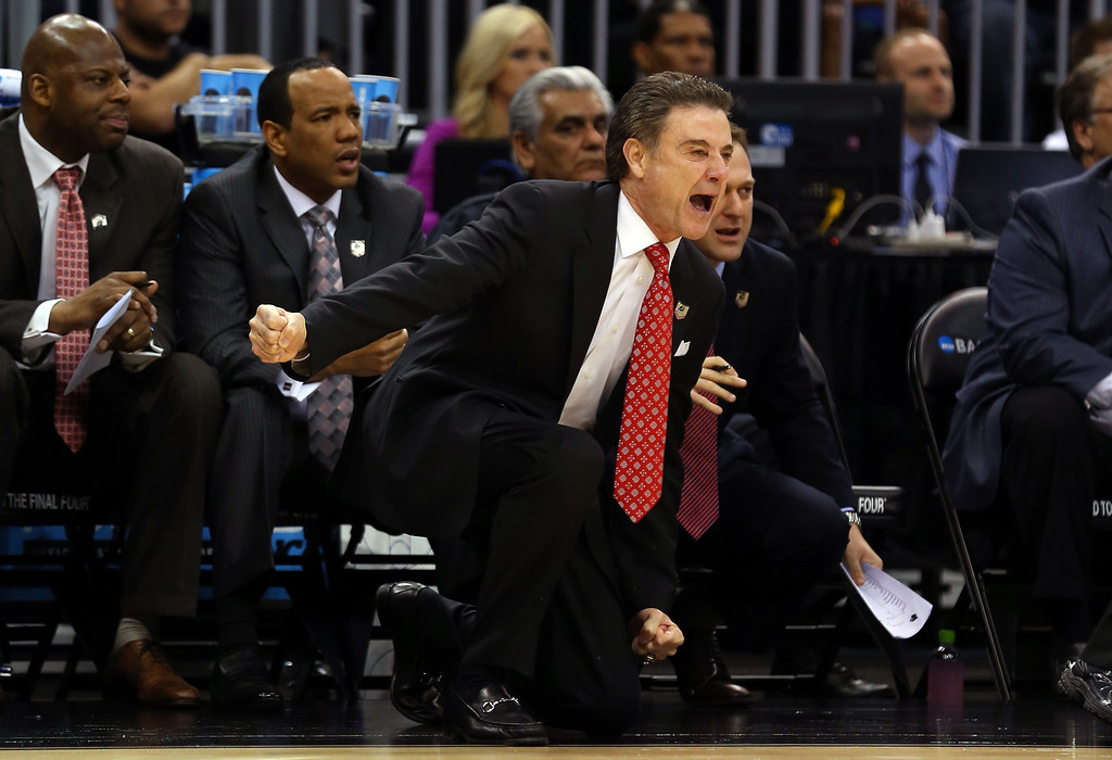 . Head coach Rick Pitino of the Louisville Cardinals shouts to his players against the Manhattan Jaspers during the second round of the 2014 NCAA Men\'s Basketball Tournament at Amway Center on March 20, 2014 in Orlando, Florida.  (Photo by Mike Ehrmann/Getty Images)