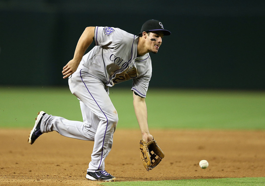 . Infielder Nolan Arenado #28 of the Colorado Rockies feilds a ground ball out against the Arizona Diamondbacks during the MLB game at Chase Field on July 7, 2013 in Phoenix, Arizona.  (Photo by Christian Petersen/Getty Images)