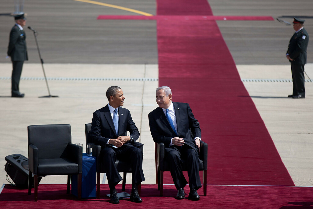 . US President Barack Obama talks to Israeli Prime Minister Benjamin Netanyahu during an official welcoming ceremony on his arrival at Ben Gurion International Airport on March, 20, 2013 near Tel Aviv, Israel. (Photo by Uriel Sinai/Getty Images)