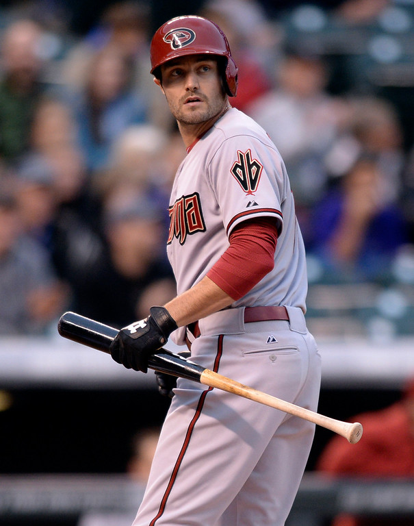 . DENVER, CO - APRIL 5:  Arizona batter A.J. Pollock returned to the dugout after striking out in the first inning. The Colorado Rockies hosted the Arizona Diamondbacks Saturday night, April 5, 2014 in Denver. (Photo by Karl Gehring/The Denver Post)