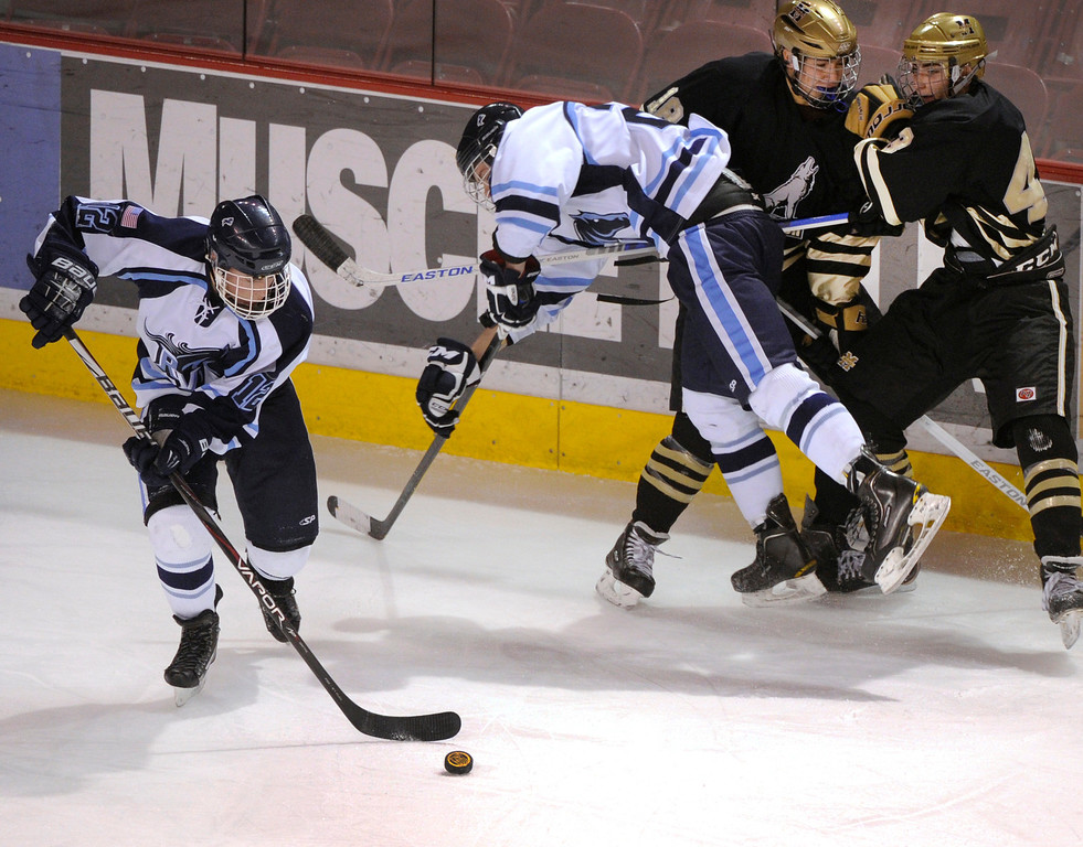 . DENVER, CO. - FEBRUARY 28: Mustangs forward Victor Lombardi (12) controlled the puck in the first period. Monarch High School matched up against Ralston Valley Friday night, March 1, 2013 in the championship game of the state hockey playoffs at Magness Arena in Denver. (Photo By Karl Gehring/The Denver Post)