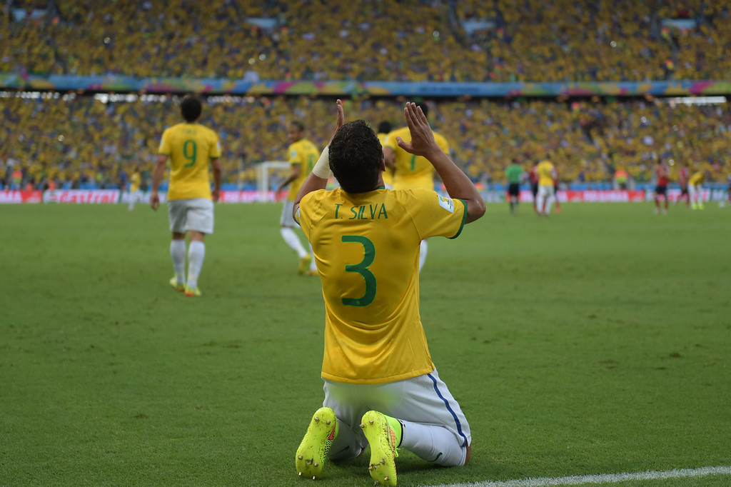 . Brazil\'s defender and captain Thiago Silva celebrates after scoring during the quarter-final football match between Brazil and Colombia at the Castelao Stadium in Fortaleza during the 2014 FIFA World Cup on July 4, 2014. EITAN ABRAMOVICH/AFP/Getty Images