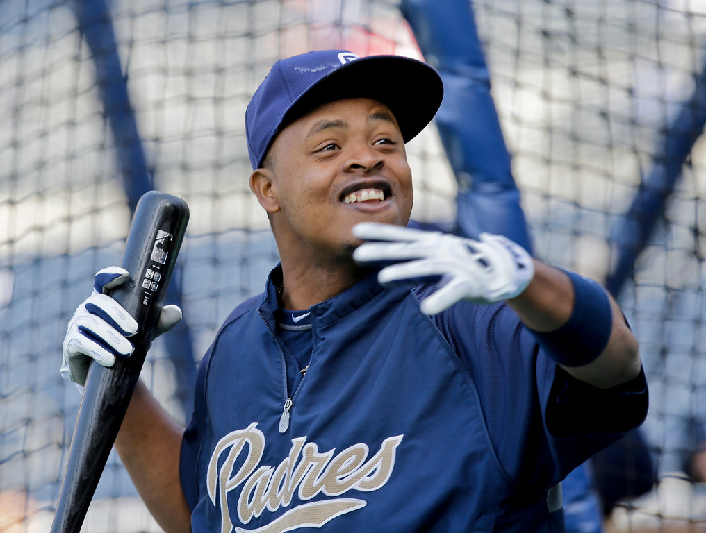 . San Diego Padres\' Edinson Volquez gets animated telling a story outside the batting cage during pre-game warm ups for a baseball game against the Colorado Rockies, Friday April 12, 2013, in San Diego. (AP photo/Lenny Ignelzi)