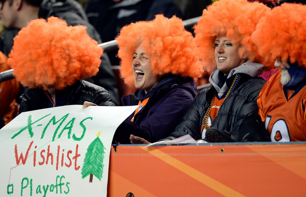 . Broncos fans cheer on the team during the first quarter.  The Denver Broncos vs. the San Diego Chargers at Sports Authority Field at Mile High in Denver on December 12, 2013. (Photo by Hyoung Chang/The Denver Post)