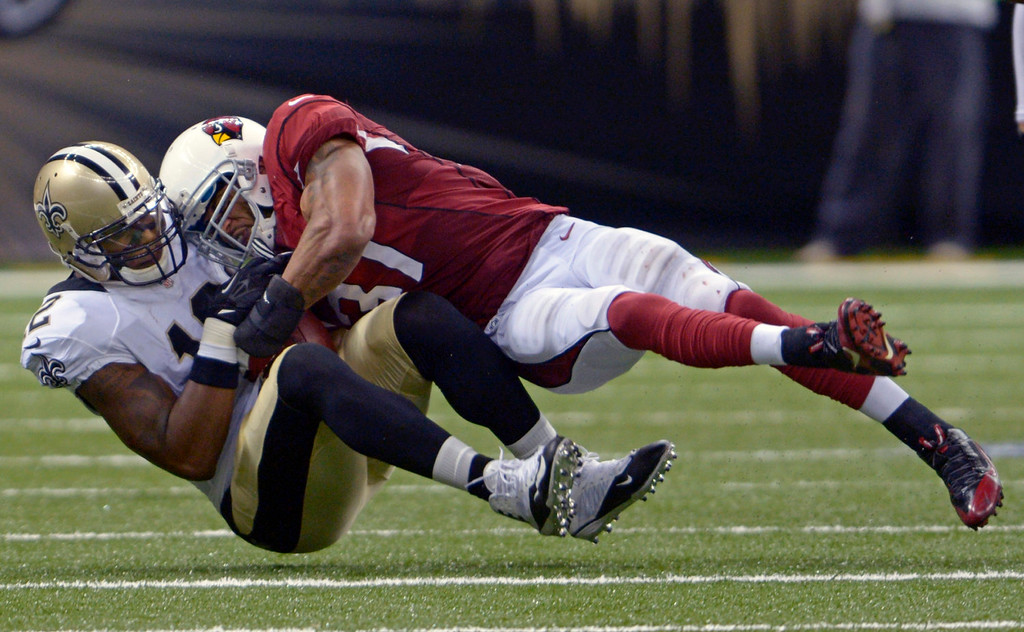 . Arizona Cardinals strong safety Yeremiah Bell (37) hits New Orleans Saints wide receiver Marques Colston (12) in the second half of an NFL football game in New Orleans, Sunday, Sept. 22, 2013. (AP Photo/Bill Feig)