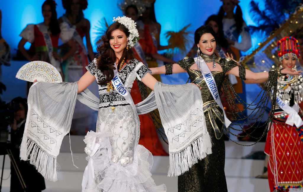 . Miss Mexico Lucero Montemayor (L) performs during the national costume catwalk at the Miss International beauty contest in Tokyo, Japan, 17 December 2013.  EPA/KIMIMASA MAYAMA