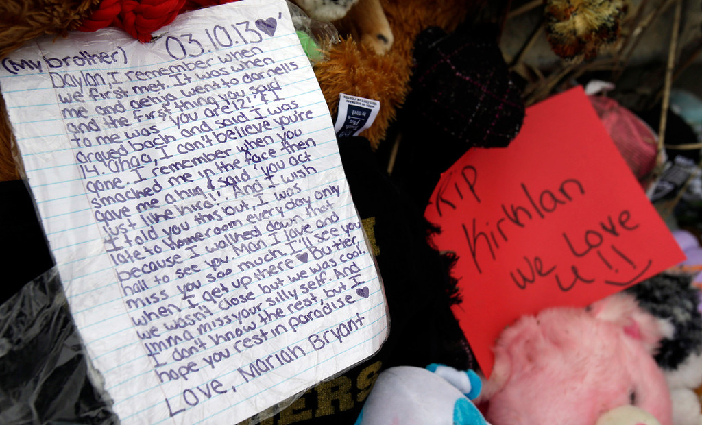 . A note rests on a memorial where six teens died early Sunday in Warren, Ohio, on Monday, March 11, 2013. (AP Photo/Tony Dejak)