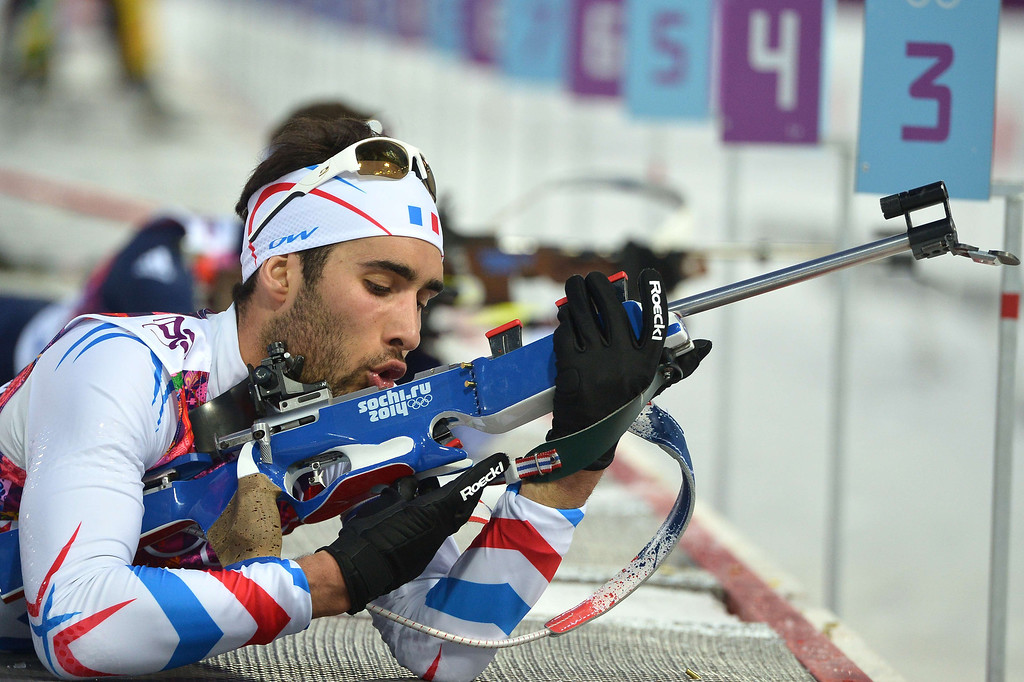 . Gold medalist France\'s Martin Fourcade competes at the range in the Men\'s Biathlon 20 km Individual at the Laura Cross-Country Ski and Biathlon Center during the Sochi Winter Olympics on February 13, 2014 in Rosa Khutor near Sochi.  ALBERTO PIZZOLI/AFP/Getty Images