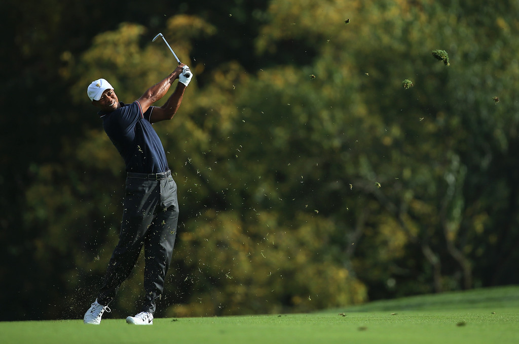 . DUBLIN, OH - OCTOBER 03:  Tiger Woods of the U.S. Team hits his approach shot on the tenth hole during the Day One Four-Ball Matches at the Muirfield Village Golf Club on October 3, 2013  in Dublin, Ohio.  (Photo by Andy Lyons/Getty Images)