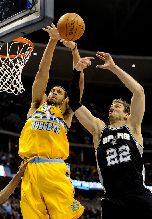 . Denver center JaVale McGee (34) worked against Spurs center Tiago Splitter (22) in the second half. The Denver Nuggets defeated the San Antonio Spurs 112-106 at the Pepsi Center Tuesday night, December 18, 2012. Karl Gehring/The Denver Post