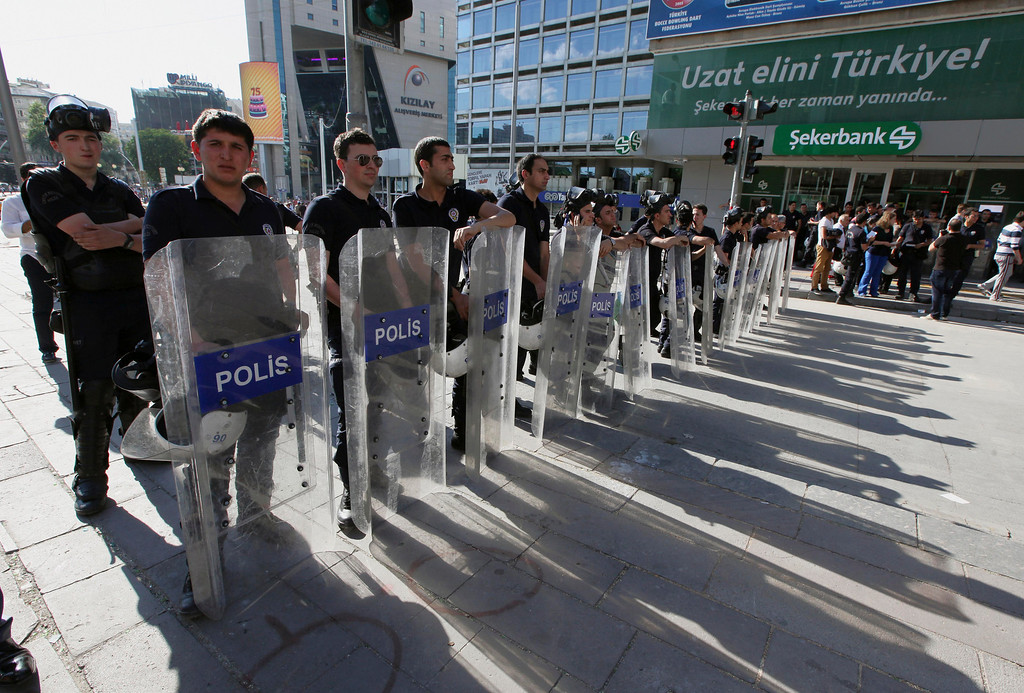 . Riot police stand as Turkish youths shout anti-government slogans, in Ankara, Turkey, Tuesday, June 4, 2013.  (AP Photo/Burhan Ozbilici)
