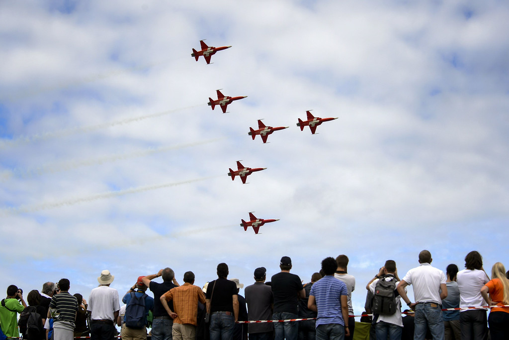 """. Fighter jets of the \""""Patrouille Suisse\"""" (Swiss patrol) perform during the first day of AIR14 airshow on August 30, 2014 in Payerne, western Switzerland.  AFP PHOTO / FABRICE COFFRINI/AFP/Getty Images"""