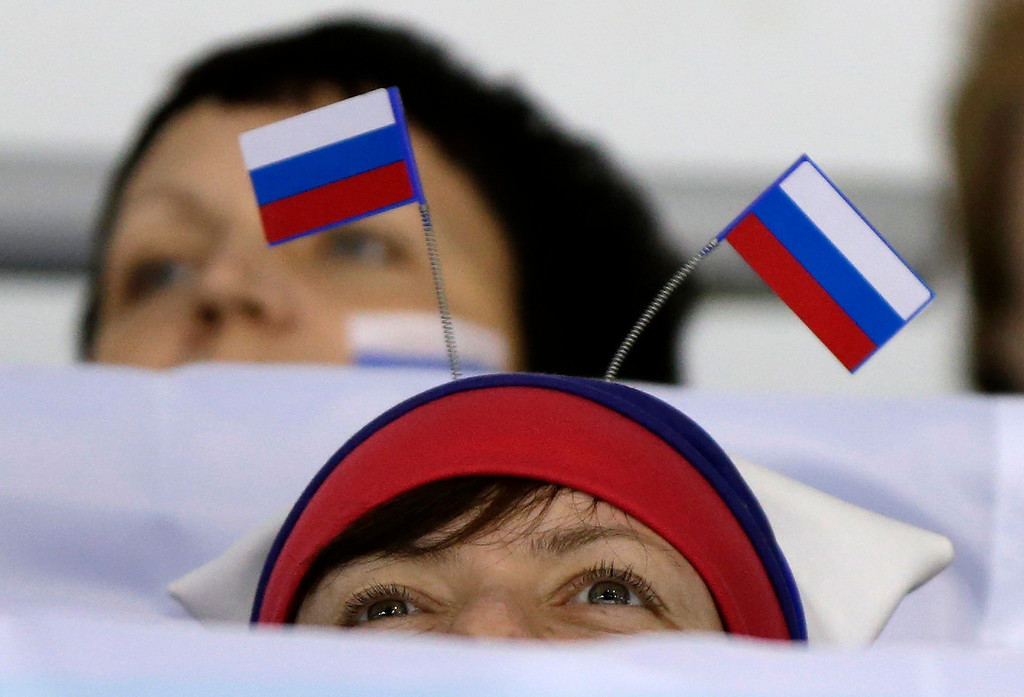 . A Russian fan wears her country\'s flags at the women\'s curling competition at the 2014 Winter Olympics, Monday, Feb. 10, 2014, in Sochi, Russia. (AP Photo/Robert F. Bukaty)