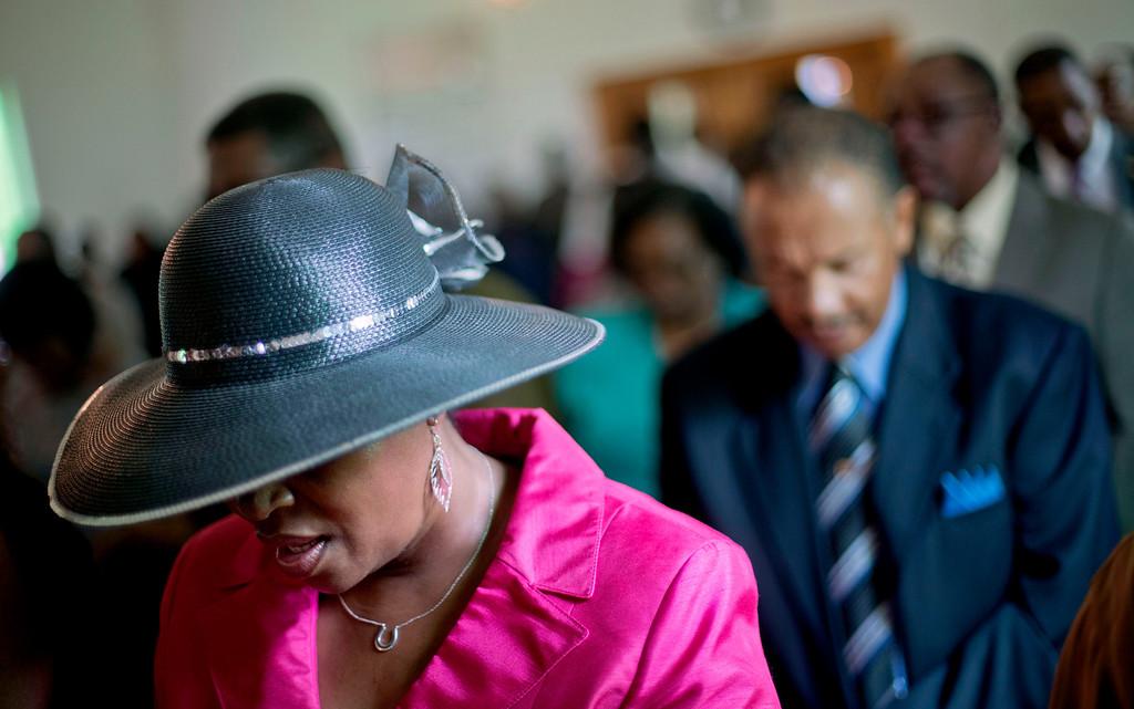 . Delicia Ellison attends a church service for the 129th anniversary of St. Luke Baptist Church on Sapelo Island, Ga. on Sunday, June 9, 2013. (AP Photo/David Goldman)