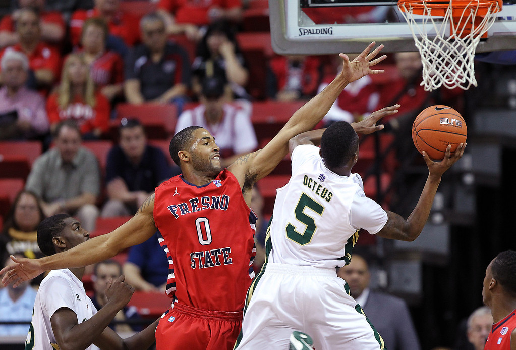 . Fresno State\'s Jerry Brown (0) attempts to block a shot from Colorado State\'s Jonathan Octeus (5) during the first half of a Mountain West Conference tournament NCAA college basketball game, Wednesday, March 13, 2013, in Las Vegas. (AP Photo/Isaac Brekken)