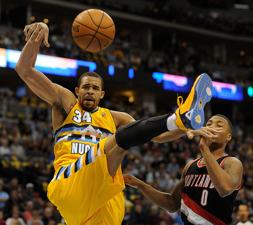 . DENVER, CO. - NOVEMBER 1:  Denver center JaVale McGee (34) failed on an off-balance attempt in the first half. The Denver Nuggets hosted the Portland Trail Blazers Friday night, November 1, 2013 at the Pepsi Center.  Photo By Karl Gehring/The Denver Post