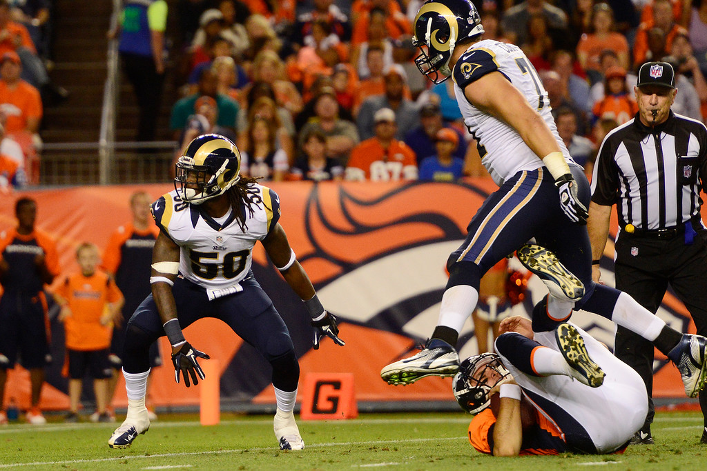 . DENVER, CO - AUGUST 24: Ray-Ray Armstrong (50) of the St. Louis Rams celebrates after sacking Brock Osweiler (17) of the Denver Broncos during the second half of action of an NFL preseason game at Sports Authority Field at Mile High on August 24, 2013. This is the third game of the preseason for the Broncos. (Photo by AAron Ontiveroz/The Denver Post)