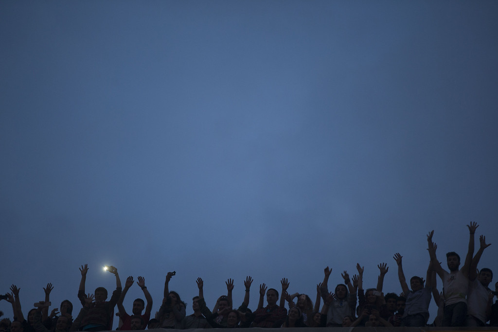 . Protestors gather on a rooftop in Taksim Square on June 4, 2013 in Istanbul, Turkey.  (Photo by Uriel Sinai/Getty Images)