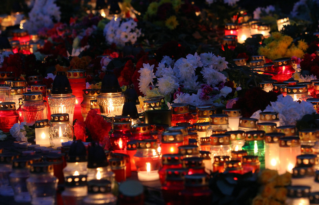 . Flowers and candles are laid down at the accident site of a collapsed Maxima supermarket in Riga on November 23, 2013, where the roof of the building caved in on shoppers on November 21.    AFP PHOTO / PETRAS  MALUKAS/AFP/Getty Images
