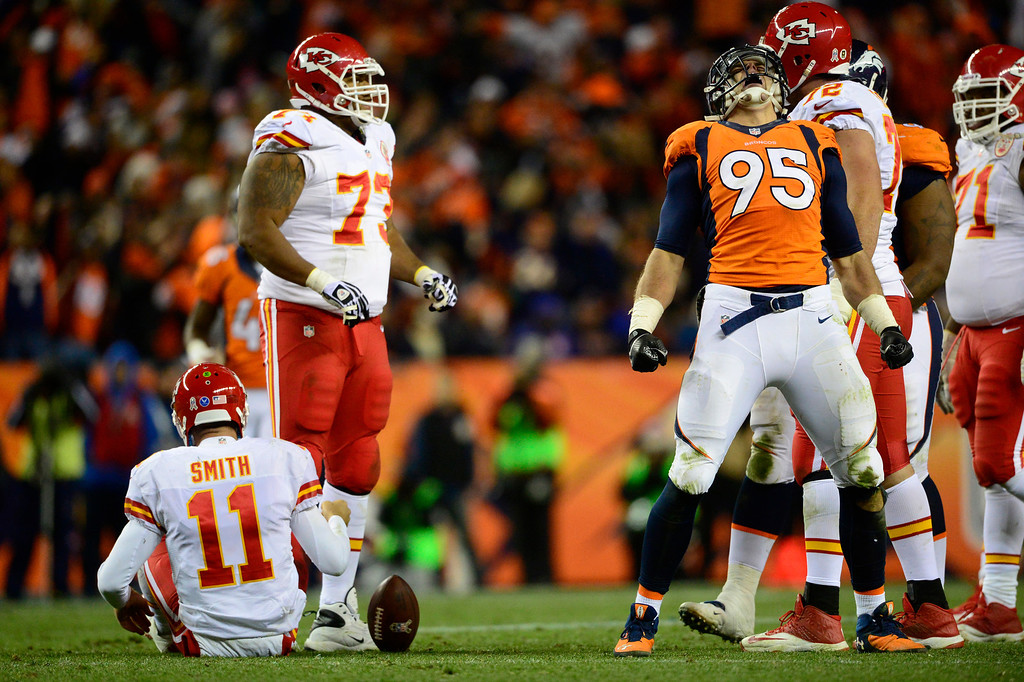 . DENVER, CO - NOVEMBER 17: Denver Broncos defensive end Derek Wolfe (95) celebrates after tackling Kansas City Chiefs quarterback Alex Smith (11) in the third quarter. The Denver Broncos take on the Kansas City Chiefs at Sports Authority Field at Mile High in Denver on November 17, 2013. (Photo by AAron Ontiveroz/The Denver Post)