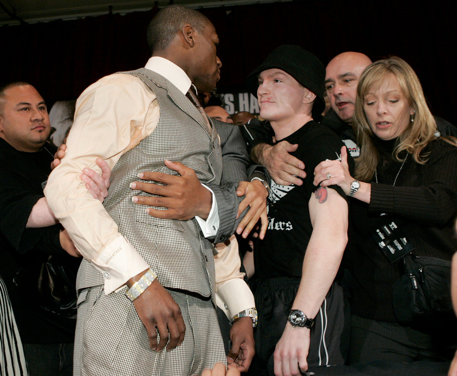 . WBC welterweight champion Floyd Mayweather Jr., left, and Ricky Hatton, of Britain, are pulled apart after Mayweather Jr. pushed Hatton at a news conference held at the MGM Grand hotel and casino in Las Vegas, Wednesday, Dec. 5, 2007. The two will fight in a WBC welterweight title match, Saturday, Dec. 8, in Las Vegas. (AP Photo/Jae C. Hong)