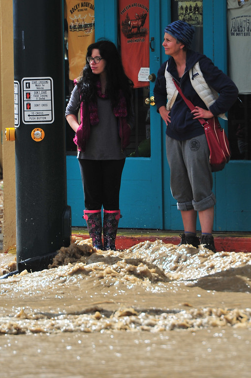 . Locals test to see how close they can get to their shops on Friday, September 13, 2013. Rising water from the Fall River divided parts of town, making travel dangerous or even impossible on Friday. Walt Hester/Estes Park Trail-Gazette