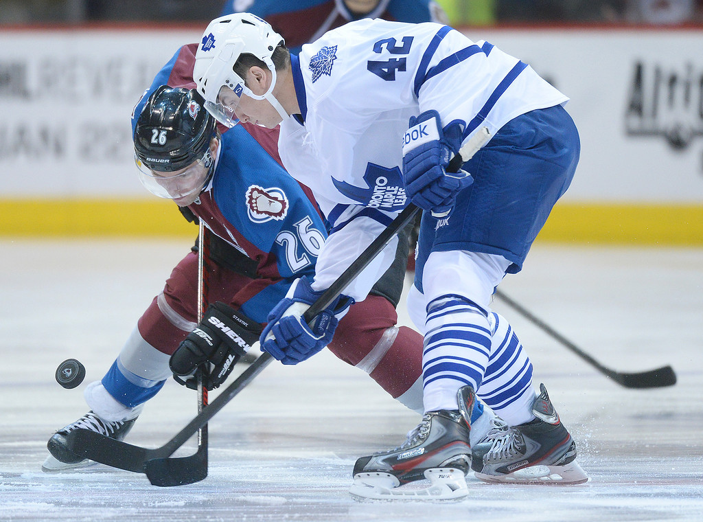 . DENVER, CO. - JANUARY 21:  Colorado center Paul Stastny (26) faced off against Toronto\'s Tyler Bozak (42) in the first period. The Colorado Avalanche hosted the Toronto Maple Leafs Tuesday night, January 21, 2014 at the Pepsi Center. Photo By Karl Gehring/The Denver Post