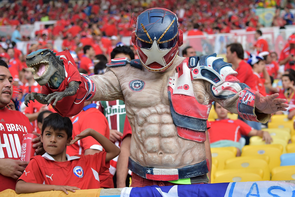 . A Chilean supporter holds a plastic toy aloft ahead of the Group B football match between Spain and Chile in the Maracana Stadium in Rio de Janeiro on June 18, 2014, during the 2014 FIFA World Cup. GABRIEL BOUYS/AFP/Getty Images