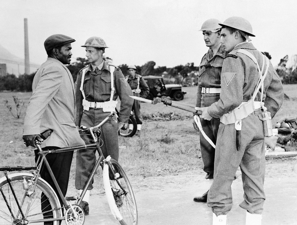 . South African marines troops control black citizens, in Nyanga, near Cape Town, 02 April 1960. Despite the state of emergency, black protestors tried to march to Cape Town to demand the release of black leaders, arrested after the Sharpeville massacre, 21 March 1960. ( OFF/AFP/Getty Images)
