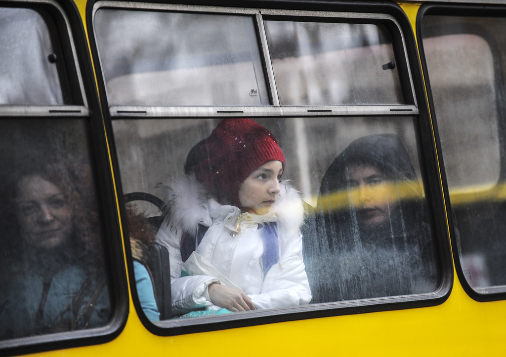 . People look on from a public transport bus in central Kiev on February 28, 2014. Deposed Ukrainian president Viktor Yanukovych, giving a news conference  in the southern Russian city of Rostov-on-Don, insisted on February 28, 2014 in his first public appearance since fleeing to Russia that he had not been overthrown and would continue to fight for the future of Ukraine. AFP PHOTO/BULENT KILICBULENT KILIC/AFP/Getty Images