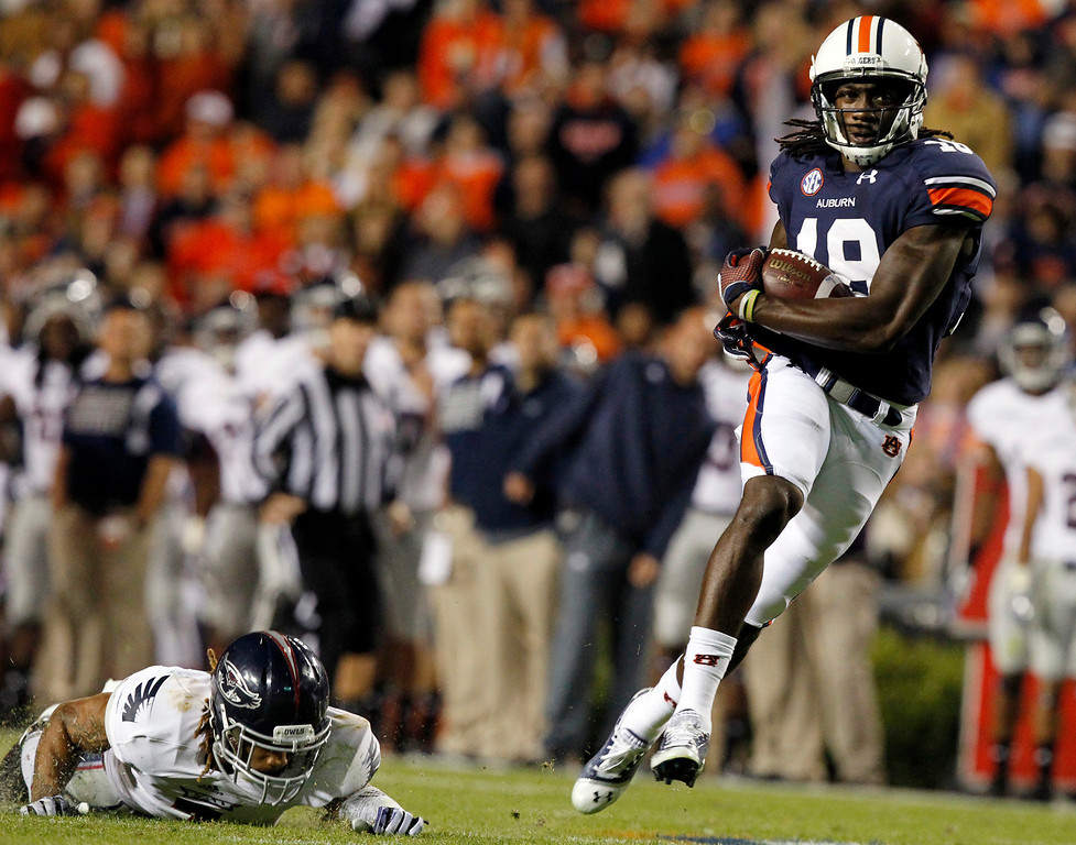 . Auburn wide receiver Sammie Coates, right, catches a pass over Florida Atlantic defensive back Cre\'von LeBlanc for a touchdown during the first half of an NCAA college football game Saturday, Oct. 26, 2013, in Auburn, Ala. (AP Photo/Butch Dill)