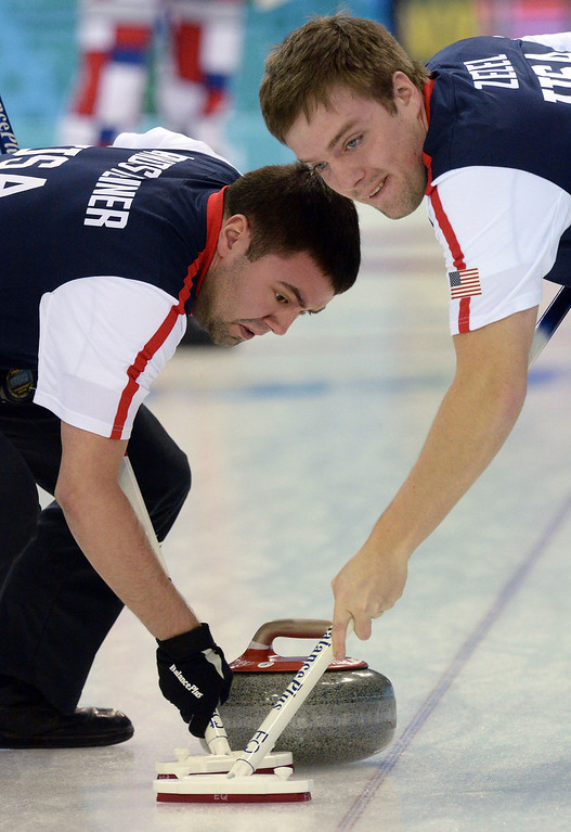. Jared Zezel (R) and John Landsteiner of the US clean the way for the stone during the men\'s curling round robin session 2 match between Norway and USA at the Ice Cube curling centre in Sochi on February 10, 2014 during the 2014 Sochi Winter Olympics.    YURI KADOBNOV/AFP/Getty Images