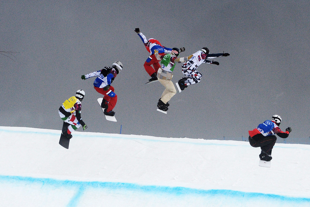 . Competitors take a jump in the final of the Menës Snowboard Cross at Rosa Khutor Extreme Park at the Sochi 2014 Olympic Games, Krasnaya Polyana, Russia, 18 February 2014.  EPA/VASSIL DONEV