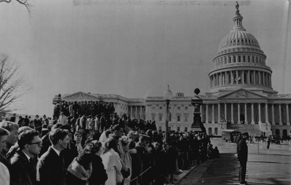 . A crowd gathers at the front of the U.S. Capitol, awaiting the moving of Kennedy\'s body to a place of honor in the Capitol rotunda in 1963.