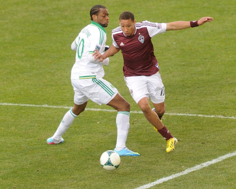 . Chris Klute (15) of the Colorado Rapids tried to get around Timbers\' forward Frederic Piquionne (10) in the second half. The Colorado Rapids tied the Portland Timbers 2-2 Saturday, March 30, 2013 at Dick\'s Sporting Goods Park in Commerce City.  Photo By Karl Gehring/The Denver Post)