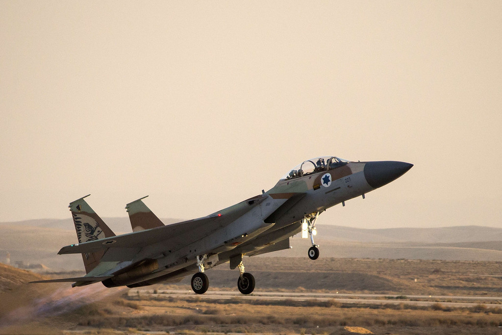 . An Israeli F-15 I fighter jet takes off during an air show at the graduation ceremony of Israeli air force pilots at the Hatzerim base in the Negev desert, near the southern Israeli city of Beersheva on December 26, 2013. AFP PHOTO / JACK GUEZ/AFP/Getty Images