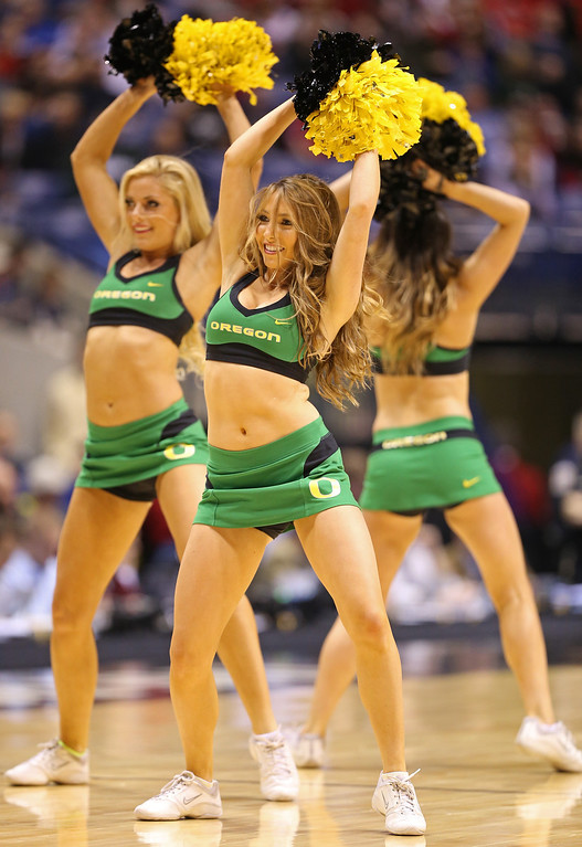. Cheerleaders for the Oregon Ducks perform in the first half against the Louisville Cardinals during the Midwest Region Semifinal round of the 2013 NCAA Men\'s Basketball Tournament at Lucas Oil Stadium on March 29, 2013 in Indianapolis, Indiana.  (Photo by Andy Lyons/Getty Images)