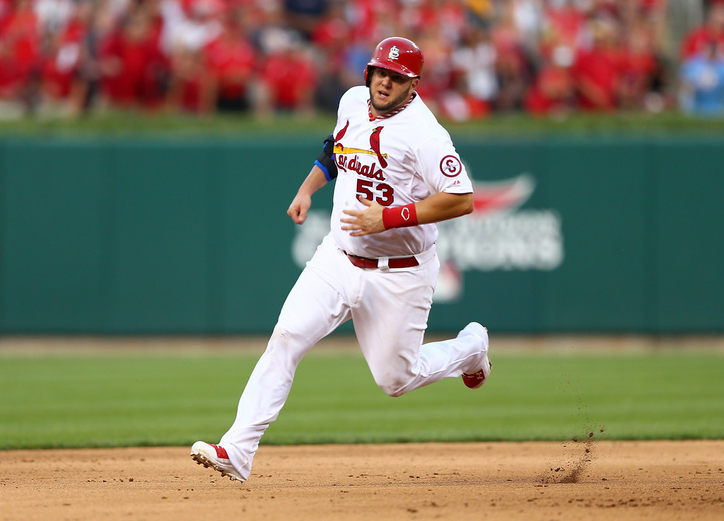 . ST LOUIS, MO - OCTOBER 03:  Matt Adams #53 of the St. Louis Cardinals heads to third after a double by Yadier Molina #4 in the sixth inning against the Pittsburgh Pirates during Game One of the National League Division Series at Busch Stadium on October 3, 2013 in St Louis, Missouri. Adams would come around to score on a throwing error by Andrew McCutchen #22 of the Pittsburgh Pirates. (Photo by Elsa/Getty Images)
