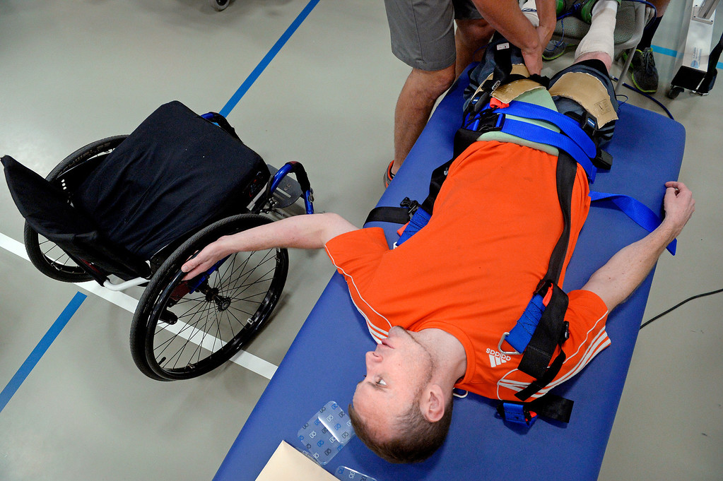 """. The balance of working to dump the wheelchair, while also getting on with other parts of life, is a constant struggle for James and other spinal cord patients. \""""I\'m never going to gain everything back; that\'s the truth and I\'ve accepted that.\"""" (Photo By Craig F. Walker / The Denver Post)"""