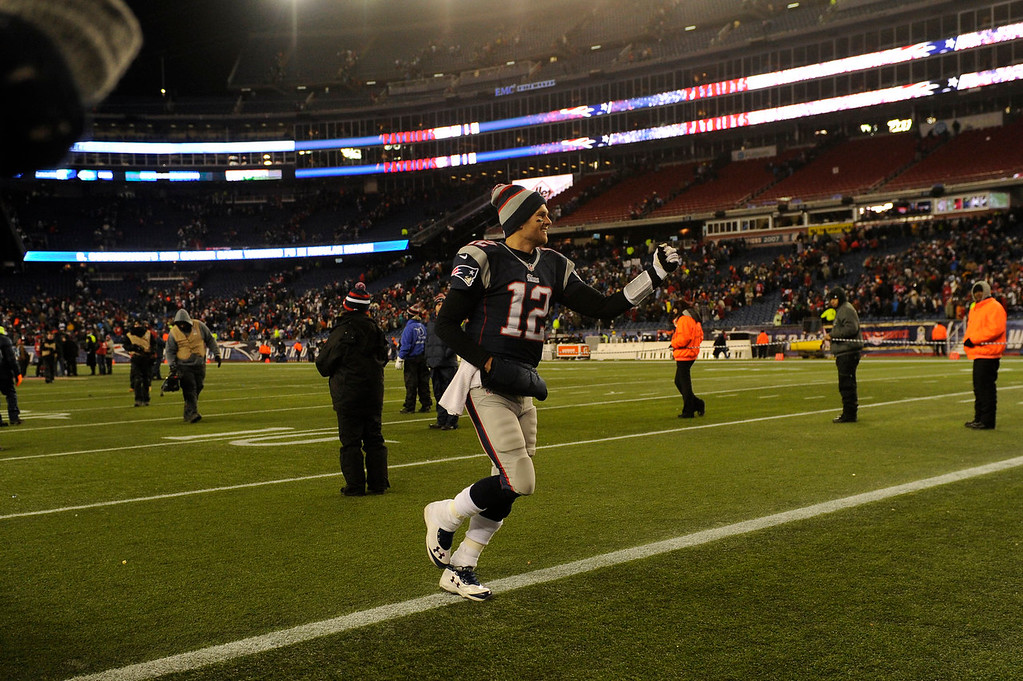 . Quarterback Tom Brady #12 of the New England Patriots heads off the field after the patriots win 43-31 at Gillette Stadium in Foxborough MA, November 24, 2013 Denver. (Photo By Joe Amon/The Denver Post)