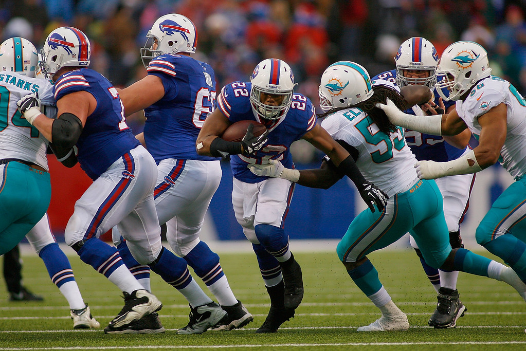 . Fred Jackson #22 of the Buffalo Bills runs against the Miami Dolphins at Ralph Wilson Stadium on December 22, 2013 in Orchard Park, New York. Buffalo won 16-0.  (Photo by Rick Stewart/Getty Images)