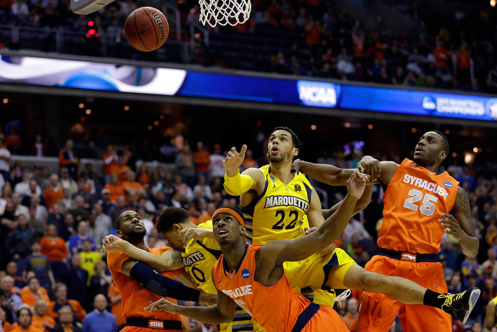 . WASHINGTON, DC - MARCH 30:  C.J. Fair #5 of the Syracuse Orange and Rakeem Christmas #25 of the Syracuse Orange fight for the rebound against Trent Lockett #22 of the Marquette Golden Eagles during the East Regional Round Final of the 2013 NCAA Men\'s Basketball Tournament at Verizon Center on March 30, 2013 in Washington, DC.  (Photo by Rob Carr/Getty Images)