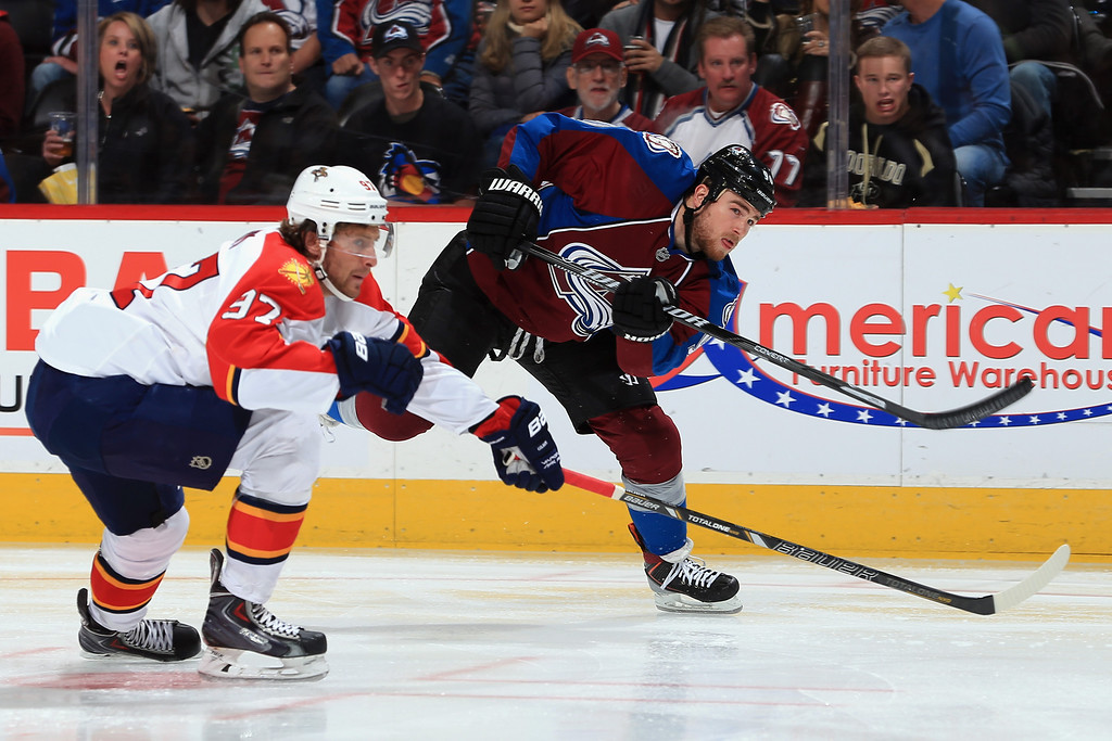 . DENVER, CO - NOVEMBER 16:  Ryan O\'Reilly #90 of the Colorado Avalanche takes a shot on goal against Matt Gilroy #97 of the Florida Panthers at Pepsi Center on November 16, 2013 in Denver, Colorado.  (Photo by Doug Pensinger/Getty Images)