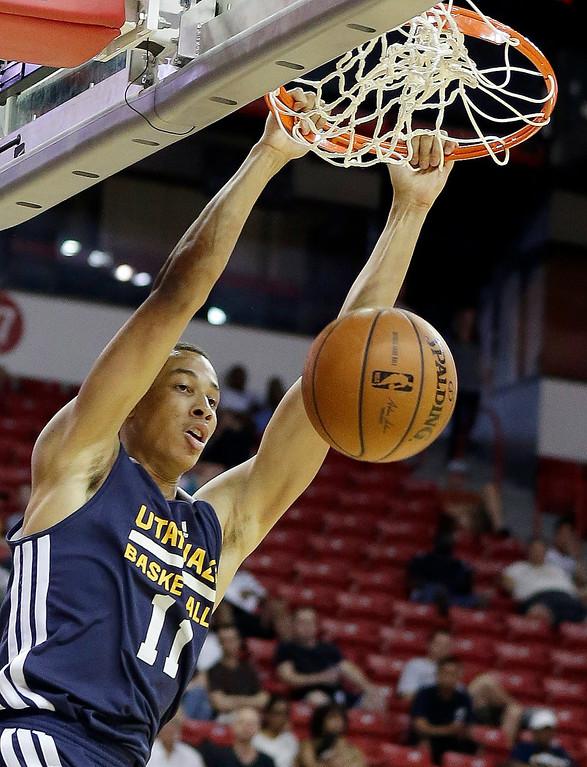 . Utah Jazz\'s Dante Exum dunks during the first half of an NBA summer league basketball game against the Denver Nuggets Tuesday, July 15, 2014, in Las Vegas. (AP Photo/Isaac Brekken)