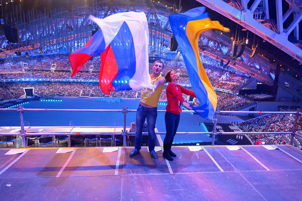 . Two spectators posing with Russian and Ukranian flags during the Opening Ceremony of the Sochi 2014 Paralympic Winter Games at Fisht Olympic Stadium on March 7, 2014 in Sochi, Russia.  (Photo by Dennis Grombkowski/Getty Images)