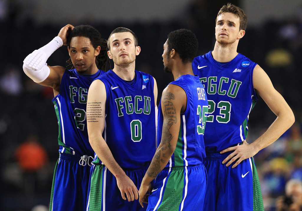 . ARLINGTON, TX - MARCH 29:  Chase Fieler #20, Dajuan Graf #35, Sherwood Brown #25, and Brett Comer #0 of the Florida Gulf Coast Eagles react late in the second half against the Florida Gators during the South Regional Semifinal round of the 2013 NCAA Men\'s Basketball Tournament at Dallas Cowboys Stadium on March 29, 2013 in Arlington, Texas.  (Photo by Ronald Martinez/Getty Images)