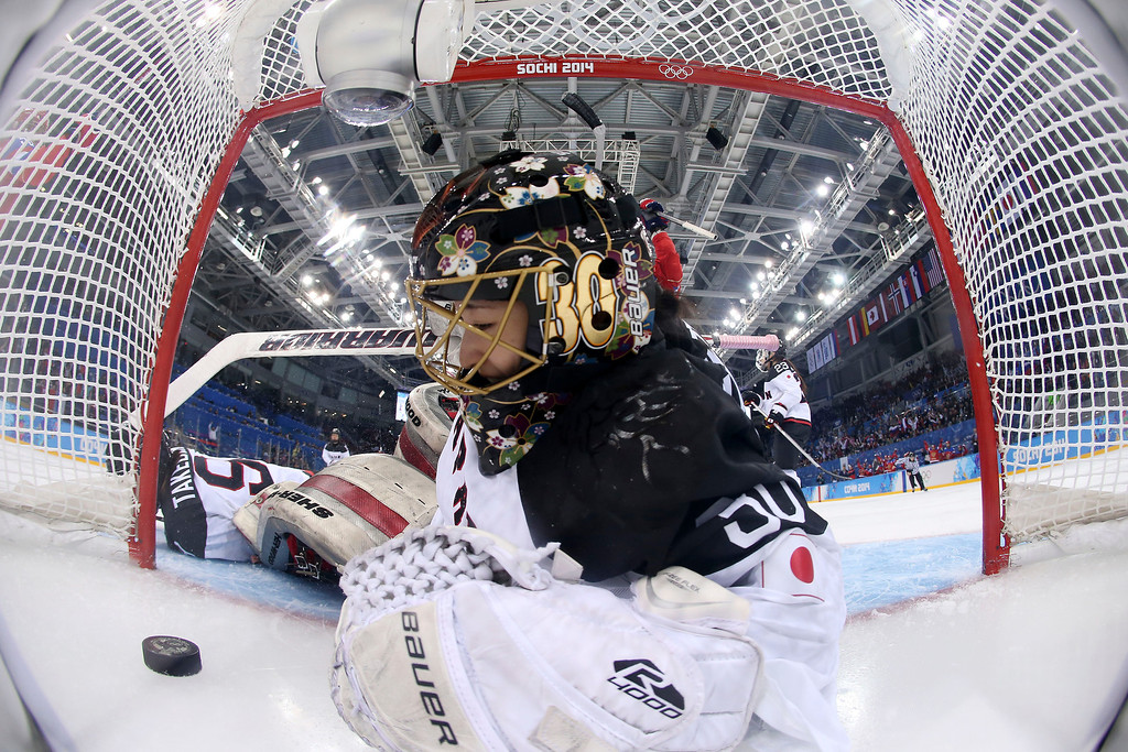 . Goalkeeper Nana Fujimoto of Japan looks at the puck after sliding in after it on a score by Galina Skiba of Russia during the 2014 Winter Olympics women\'s ice hockey game at Shayba Arena, Sunday, Feb. 16, 2014, in Sochi, Russia. Russia defeated Japan 6-3. (AP Photo/Martin Rose, Pool)