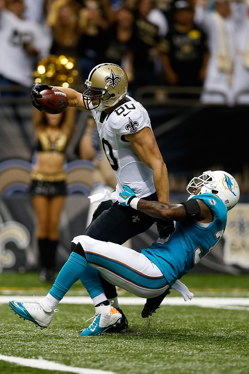 . Jimmy Graham #80 of the New Orleans Saints catches a touchdown pass over  Chris Clemons #30 of the Miami Dolphins at the Mercedes-Benz Superdome on September 30, 2013 in New Orleans, Louisiana.  (Photo by Chris Graythen/Getty Images)